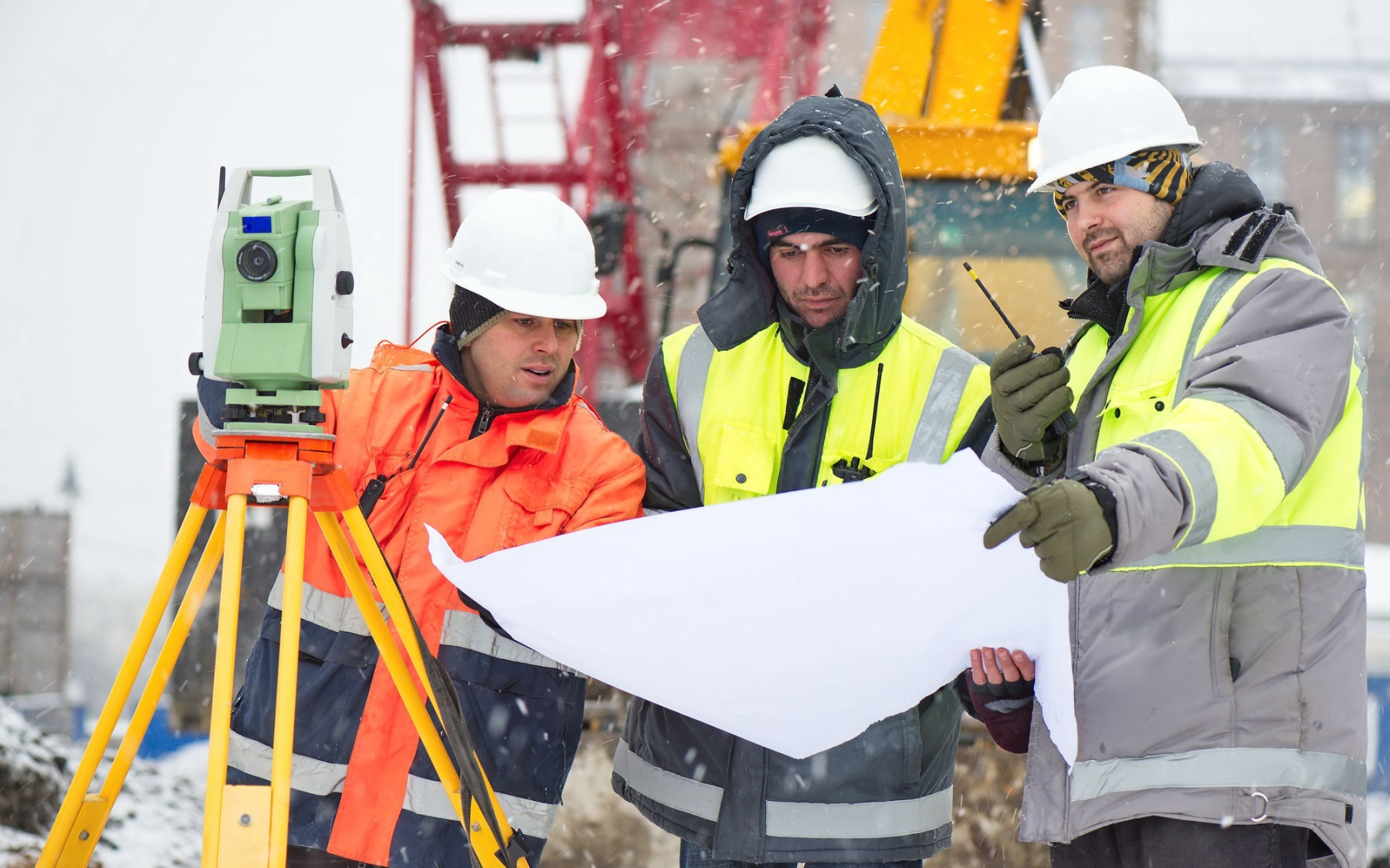 civil engineers at construction site plan on installing pile foundations in Winter