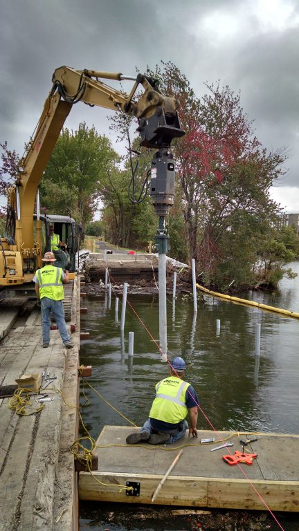 Installing helical piles underwater for a wetland boardwalk construction project